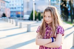 Offended ten years old blue eyed girl at the city Stock Photography
