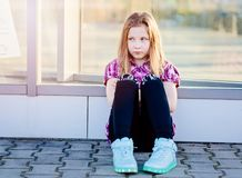 Offended ten years old blue eyed girl at the city Royalty Free Stock Image