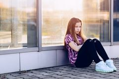 Offended ten years old blue eyed girl at the city Royalty Free Stock Photos