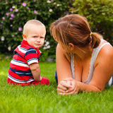 Offended toddler and his mother Royalty Free Stock Images