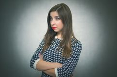 Offended woman. Resentful girl portrait. Offended and resentful woman waiting for excuses and explanations isolated on gray background Royalty Free Stock Photo