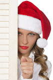 Offended woman in Santa hat showing  bad gesture Royalty Free Stock Photography