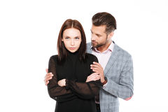 Offended young loving couple standing isolated Royalty Free Stock Photography