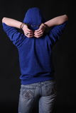 The offender in handcuffs. On a black background stock image