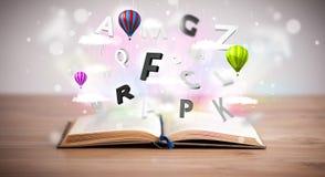 Offenes Buch mit dem Fliegen von Buchstaben 3d auf konkretem Hintergrund Stockfotografie