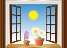 Offenes Fenster mit Blumen Stockfoto
