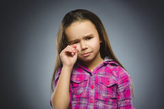 Offense crying girl  on gray background Stock Photos