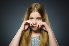 Offense crying girl isolated on gray background Royalty Free Stock Photos