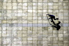 Offensive. Attacking in line hockey player on marble flag pavement Royalty Free Stock Image