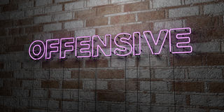 OFFENSIVE - Glowing Neon Sign on stonework wall - 3D rendered royalty free stock illustration. Can be used for online banner ads and direct mailers Stock Photo