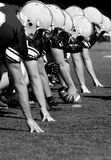 Offensive Linemen, black and white. Offensive Linemen, ready to hike the ball Stock Images