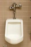 offentlig toalettpissoar Arkivfoton