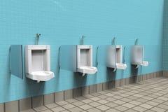 Offentliga toaletter med vita porslinpissoar i linje royaltyfri fotografi