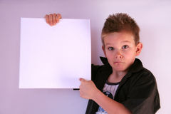 The offer. A boy is holding a frame in his hands Stock Photos