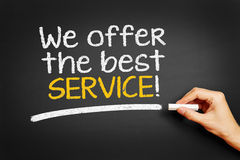 We offer the best service!. Hand writes We offer the best service on blackboard Stock Photos