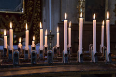 Offer candles in a venetian church, italy Royalty Free Stock Image