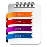 Offer paper labels on the notebook Stock Photo