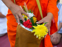 Offer sacrifice flowers to monk. Offer sacrifice flowers to Buddhist monk Stock Images