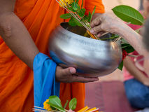 Offer sacrifice flowers to monk. Offer sacrifice flowers to Buddhist monk Stock Image