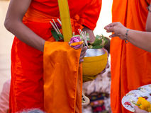 Offer sacrifice flowers to monk. Offer sacrifice flowers to Buddhist monk Stock Photo