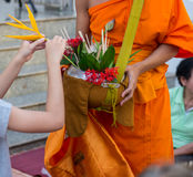 Offer sacrifice flowers to monk. Offer sacrifice flowers to Buddhist monk Stock Photography