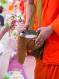 Offer sacrifice flowers to monk. Offer sacrifice flowers to Buddhist monk Stock Photos
