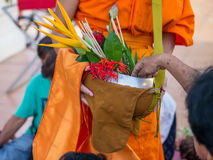 Offer sacrifice flowers to monk. Offer sacrifice flowers to Buddhist monk Royalty Free Stock Photography