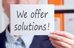 We Offer Solutions Card or Sign Royalty Free Stock Photography