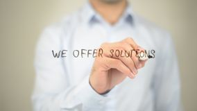 We Offer Solutions, Man writing on transparent screen stock images