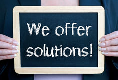 We offer solutions sign Stock Photo