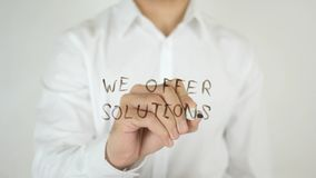 We Offer Solutions, Written on Glass. High quality Stock Photos
