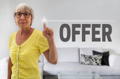 Offer touchscreen is shown by senior Stock Image