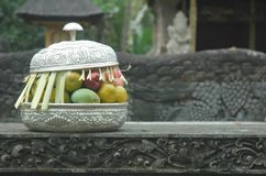 Offering. In silverware in a temple in Bali Stock Photo