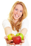 Offering apples. Happy woman holding three apples in her hands royalty free stock photography
