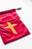 The offering bag of Christianity on white background. Stock Photos