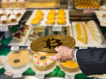 Offering bitcoin for cakes and flans in patisserie Royalty Free Stock Images