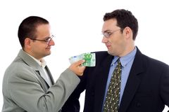 Offering bribe. Businessman or politician showing some euros as bribe Royalty Free Stock Photo