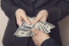 Offering a bribe Royalty Free Stock Images