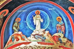 Offering. Colorful wall painting of Jesus and saints with coin offerings from Meteora Greece stock illustration