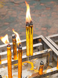 Offering cultural burning candle Royalty Free Stock Photography