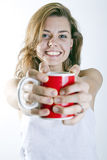 Offering a cup f coffee Royalty Free Stock Photo