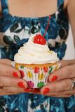 Offering a cupcake Stock Photography