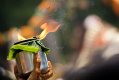 Offering of flame. An offering of flame at Chitirai, a Hindu festival in Tamil Nadu, India Stock Images
