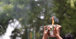 Offering of flame. An offering of flame is offered at a Hindu festival in Tamil Nadu, India Royalty Free Stock Image