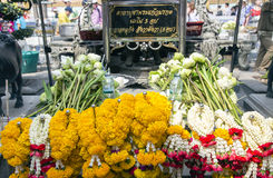 Offering of flowers in Wat Phra Kaew, Emerald Buddha Temple Royalty Free Stock Image