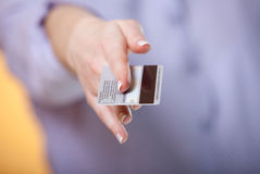 Offering gesture with a card Royalty Free Stock Photography