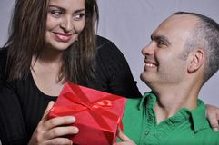 Offering a gift Royalty Free Stock Photo