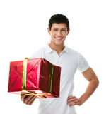 Offering a gift sporty man Stock Photography
