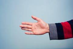 Offering handshake Stock Image