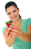 Offering Healthy Fruits. Healthy eating concept. young woman holding strawberry. isolated on white royalty free stock photos